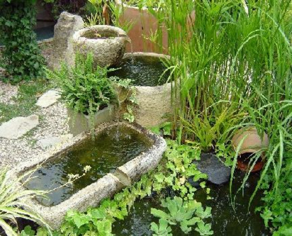 Awesome fontaine de jardin en pierre moderne ideas for Pierre de decoration jardin