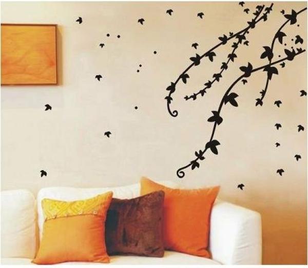 branche-sticker-mural-fleurs-noir-fauteil-coussins-orange