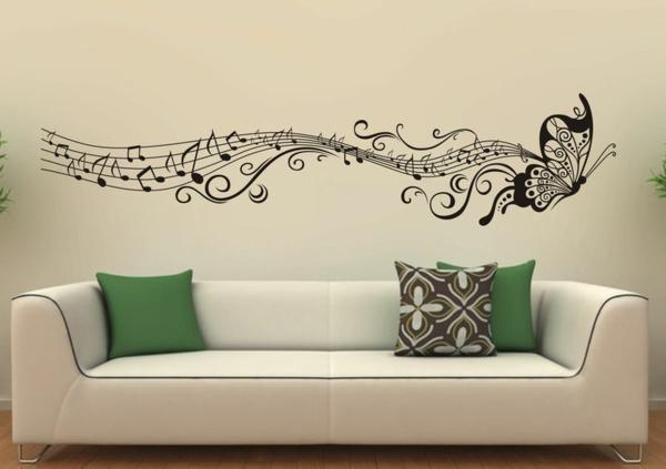 sticker-mural-noir-blanc-sofa-blanc-coussins-coloré
