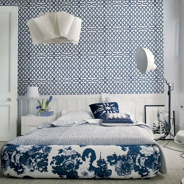 Lady-blue-bed-sheets-with-modern-wallpaper-resized