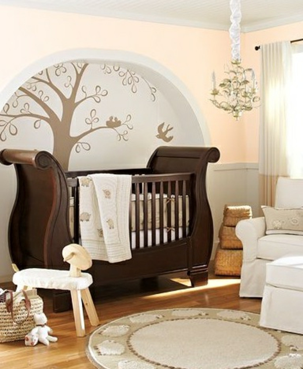 Tree-wall-decor-in-nursery-with-wooden-crib-resized