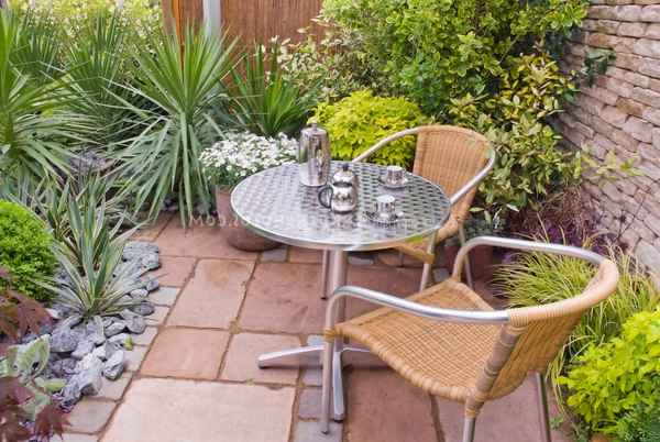Outdoor room on stone patio garden