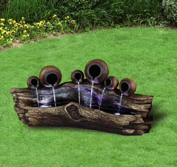 une fontaine de jardin design quelques id es en photos fascinantes. Black Bedroom Furniture Sets. Home Design Ideas