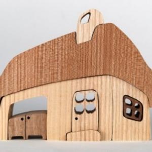 Le jouet maison en bois - pour les moments inoubliables à la maison!