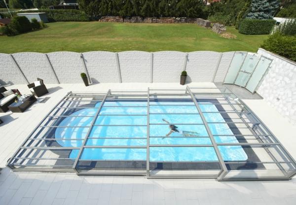 L 39 abris de piscine pour toute l 39 ann e for Abri de piscine sans rail au sol