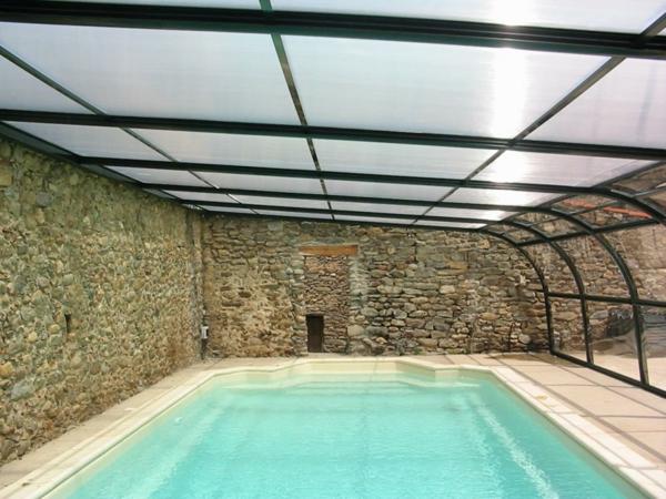 L 39 abris de piscine pour toute l 39 ann e for Construction piscine hiver