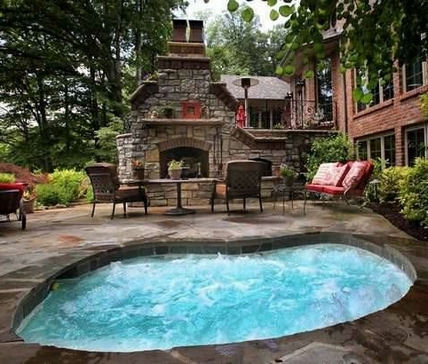 kidney-shaped-inground-jacuzzi-fireplace-outdoor-dining-area-resized