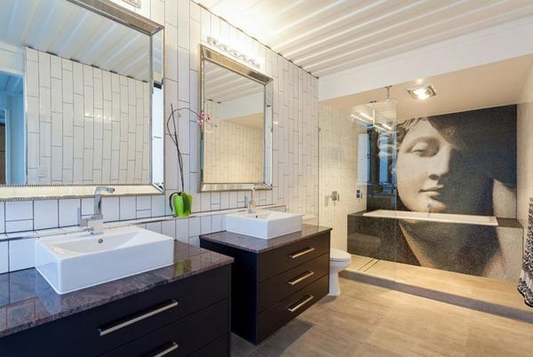 meuble-salle-de-bain-à-double-vasque-et-une-peinture-au-mur