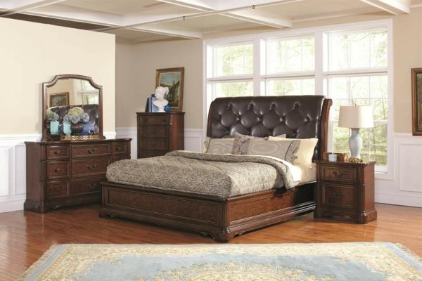 tête-de-lit-capitonnée-noire-et-un-lit-marron