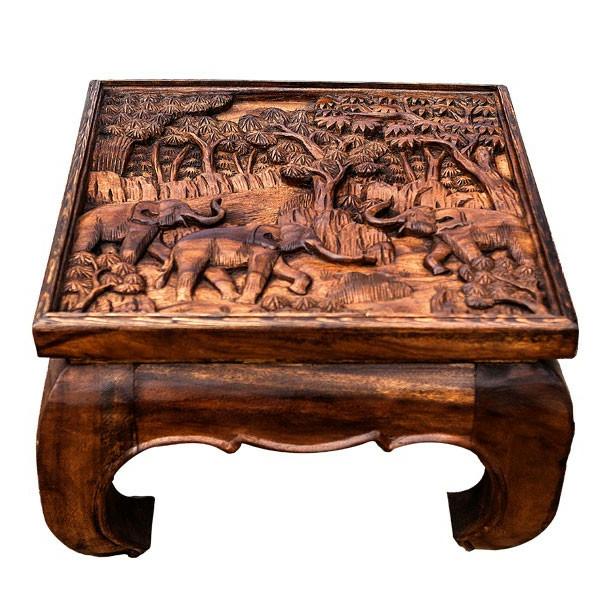table-basse-opium-avec-des-figures-d'éléphants