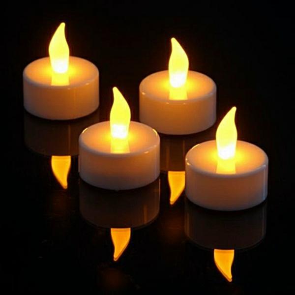 bougie-led-rechargeable-quatre-bougies-et-leur-reflection