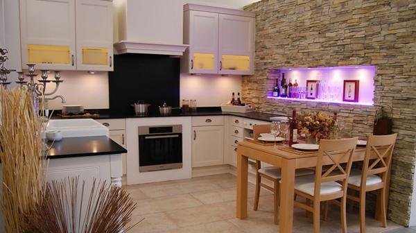 La cuisine schmidt est synonyme de style et de praticit for Mur en pierre cuisine