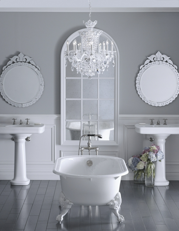 ... deux vasques sur pied, lustre led, deux ronds miroirs et style baroque