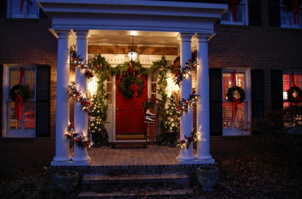 Amusing-outside-xmas-decorations-with-simple-wreaths-on-the-red-door-and-classic-hanging-lamp-and-nice-creeping-casuarina-twigs-on-the-post-and-floortile-and-brick-wall-style-resized