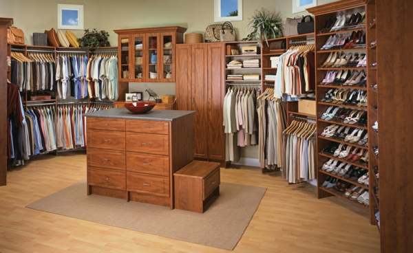 Fantastic-classic-walk-in-closet-design-with-wooden-furniture-dresser-on-the-brown-area-rug-cabinet-also-floral-arrangement-resized
