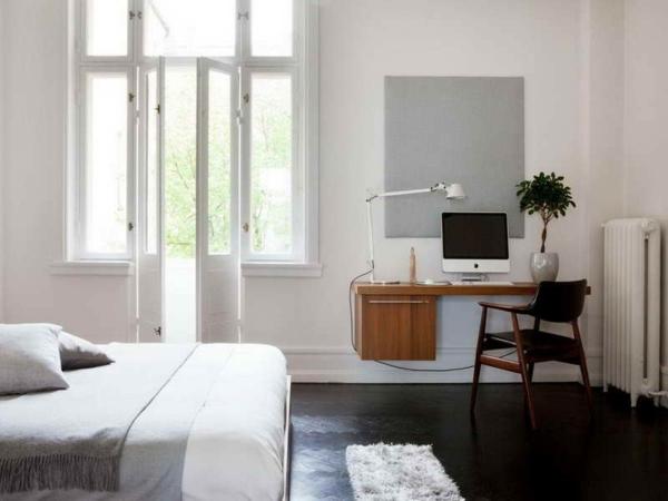 bureau-suspendu-en-bois-dans-une-chambre-à-coucher