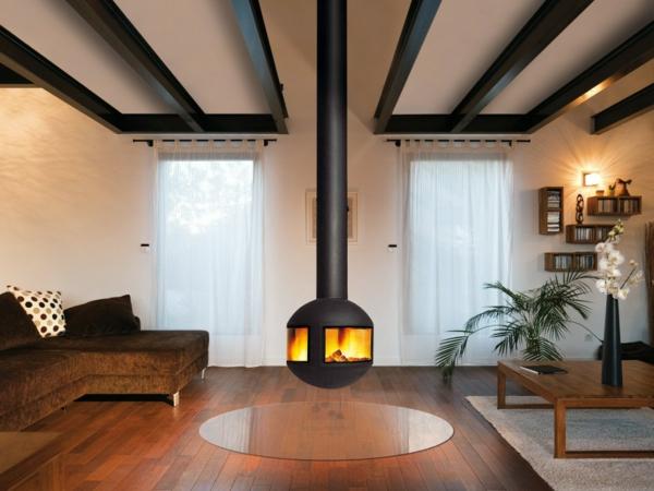 cheminée-suspendue-centrale-une-table-en-bois-et-plancher-en-bois