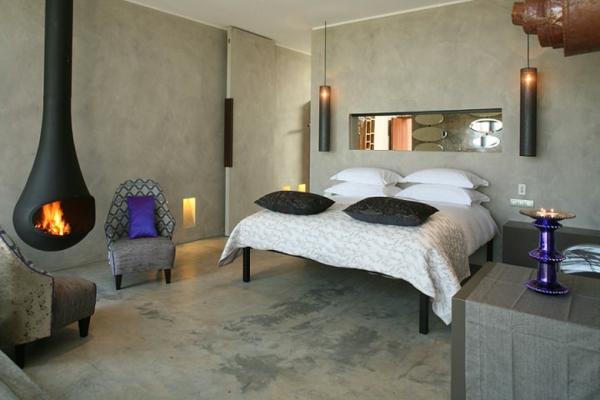 cheminée-suspendue-dans-une-chambre-à-coucher