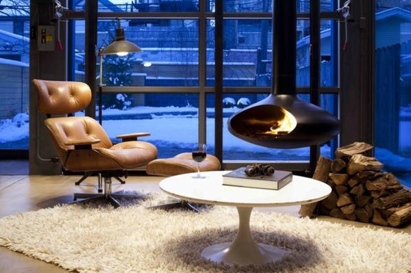 cheminée-suspendue-fauteuil-ergonomique-et-une-table-blanche