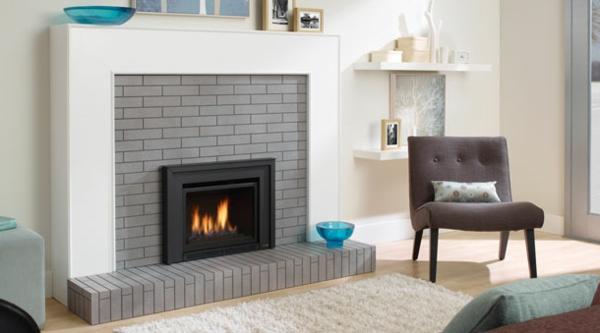 La chemin e insert moderne en fer - Idee cheminee design ...