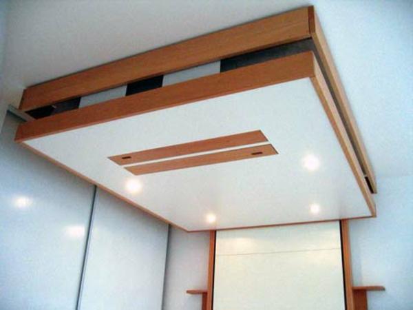 L 39 armoire lit escamotable pour plus d 39 espace for Tv escamotable plafond