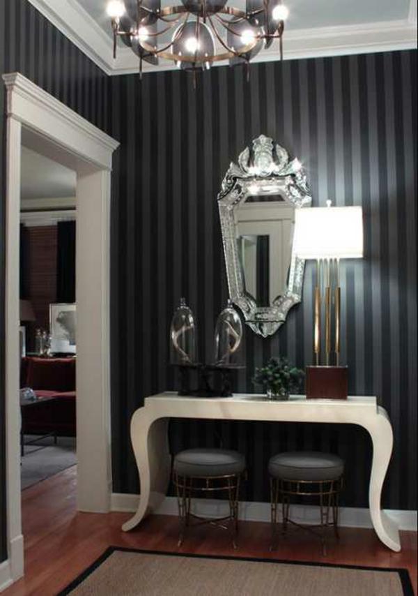 meuble-console-d entrée-une-console-noire-près-d'un-mur-noir