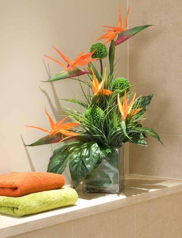 plantes-artificielles-une-fleur-orange-et-verdure-artificielle
