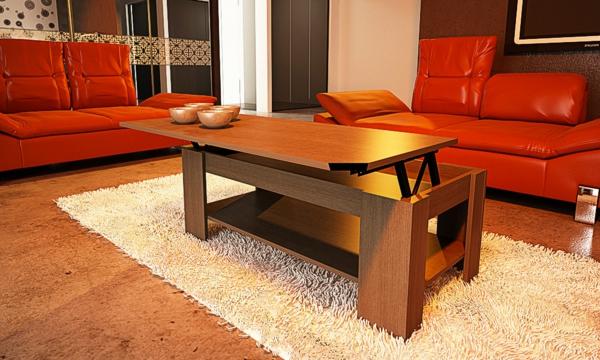 table-basse-avec-plateau-relevable-et-canapés-rouges