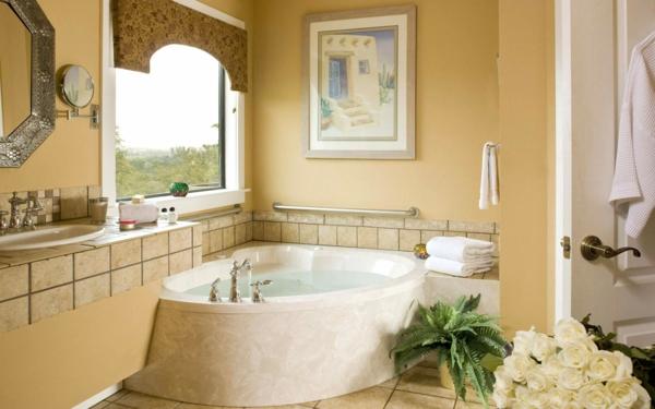 petite-baignoire-d' angle-un-miroir-encadré-et-une-peinture