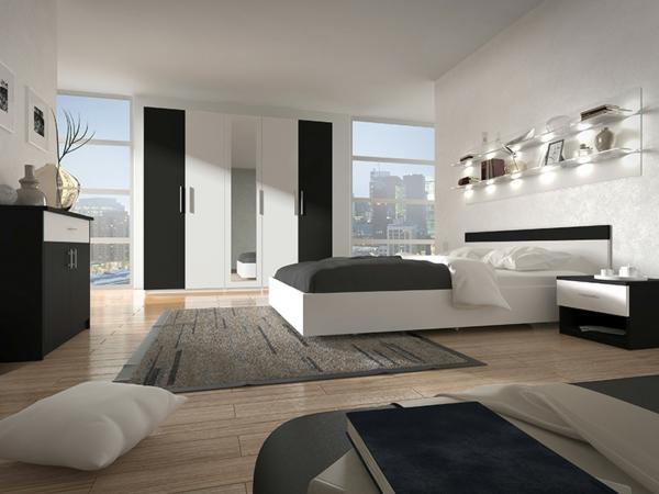 chambre-à-coucher-avec-ameublement-en-blanc-et-décoration-en-noir-avec-un-sol-en-bois