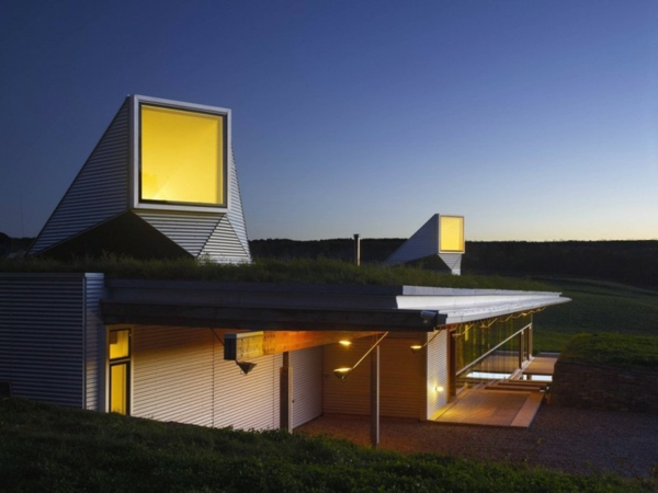 neat-and-nice-concept-for-natural-night-view-of-unique-house-with-light-scoops-in-farmland