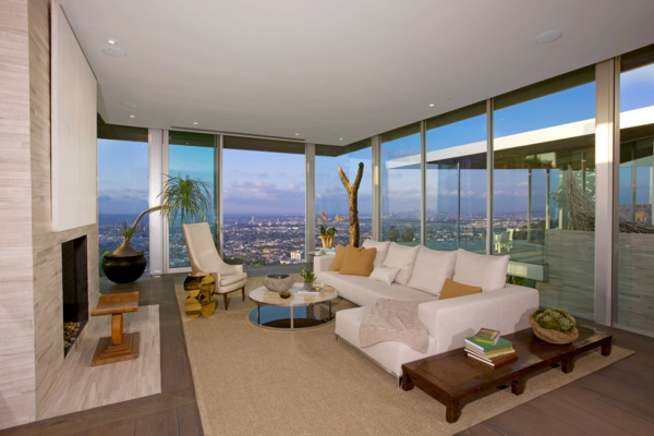 La baie vitr e coulissante pour un design spectaculaire for Petite maison luxueuse