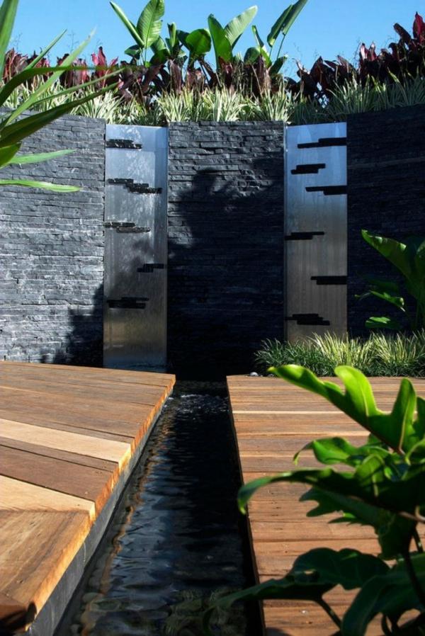 fontaine-murale-un-mur-en-briques-noires