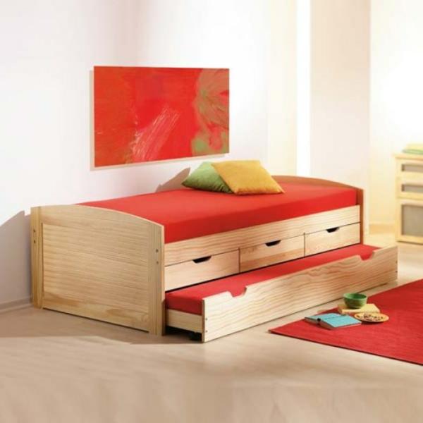 lit-en-bois-et-decoration-en-rouge