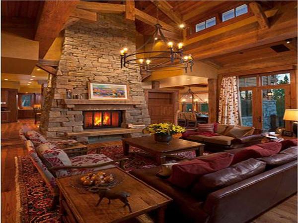 menuisierie-intérieure-sofas-en-cuir-cheminée-en-pierre-un-grand-tapis-persan