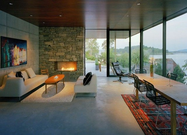 pierre-naturelle-pour-l'intérieur-grande-table-en-bois-rectangulaire-et-grandes-baies-vitrées
