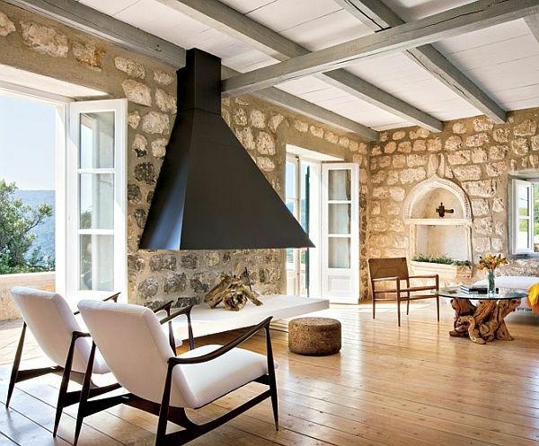 pierre-naturelle-pour-l'intérieur-un-foyer-suspendu-table-bois-flotté-et-verre-murs-en-pierre-naturelle