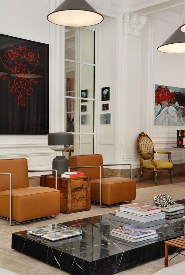 style-art-déco-fauteuils-oranges-en-cuir-table-en-marbre-noir
