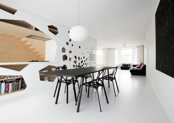 suspension-boule-espace-futuristique-table-noire-et-chaises-noires