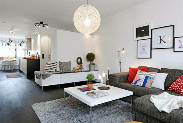 suspension-boule-table-blanche-et-sofas-gris-resized