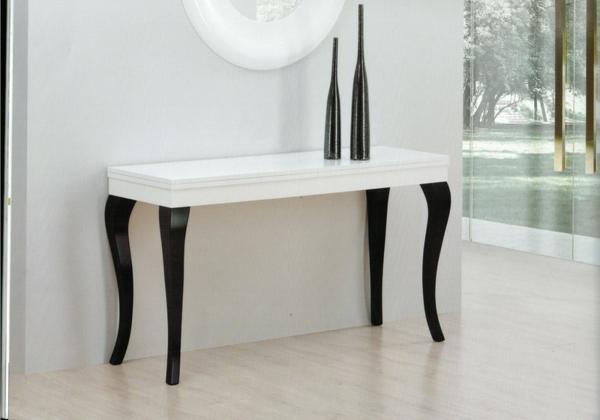 unique-élégante-table-en-blanc-avec-des-pieds-en-noir-et-des-vase-pour-votre-design-minimaliste