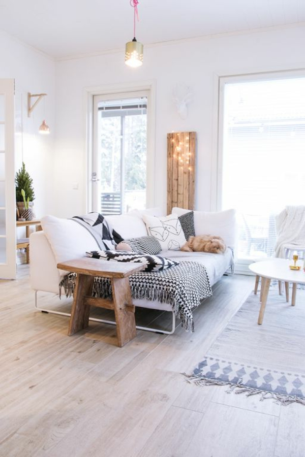décoration-scandinave-un-sofa-lit-et-lampes-pendantes