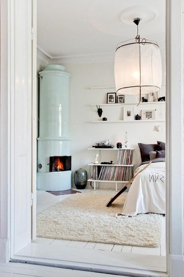décoration-scandinave-une-salle-blanche-et-un-poêle-bleu