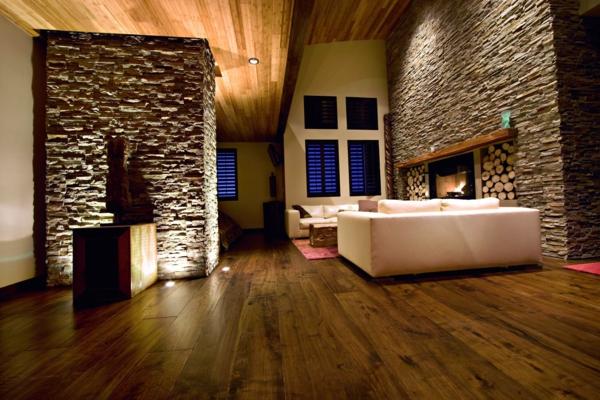 Modele Salle De Bain Orientale : Salle de séjour avec mur en pierres, sofa et cheminée