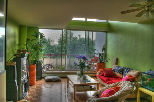interior-design-ideas-fabulous-indoor-plants-in-green-living-room-with-brown-sofa-and-wooden-coffee-table-with-purple-flowers-bouquet-in-clear-glass-vase-awesome-indoor-plant-decoration-ideas-indoor-resized