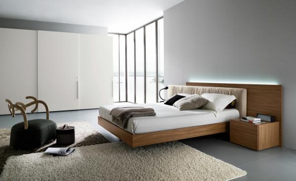 lit-suspendu-tapis-beige-armoires-blanches
