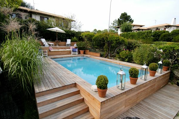 Votre piscine semi enterr e 30 id es cr atives for Piscine semi enterree