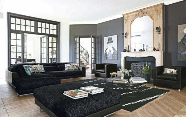 salon-roche-bobois-sofas-noirs-plancher-en-bois