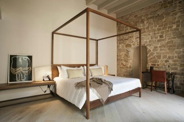 simple-design-impressive-interior-stone-salle-pièce-à-coucher-lit-pierre-sur-le-mur