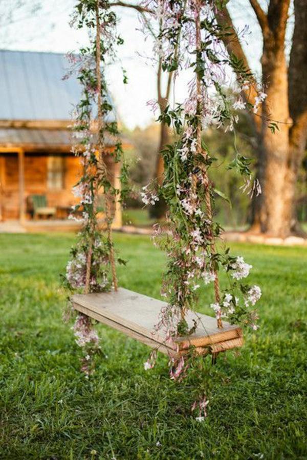 Balançoire-se-balancer-dans-le-jardin-fleurs